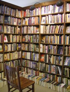 Overflowing_Dusty_Bookshelf_Shelves